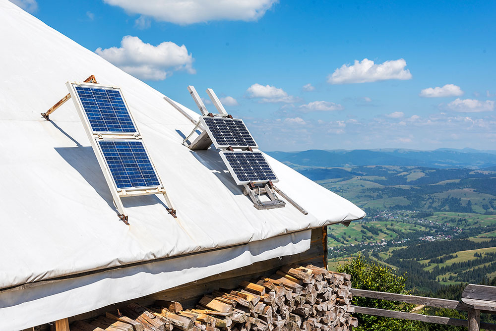 Portable solar panels on the roof of a lodge to power the best solar generator