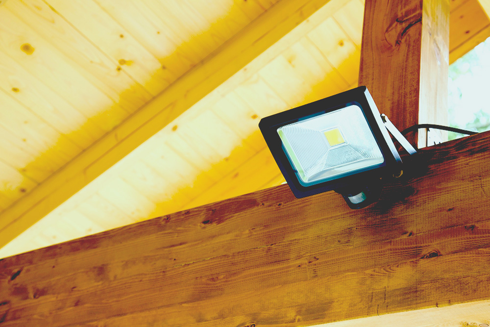 solar floodlight in outdoor carport on wood for web