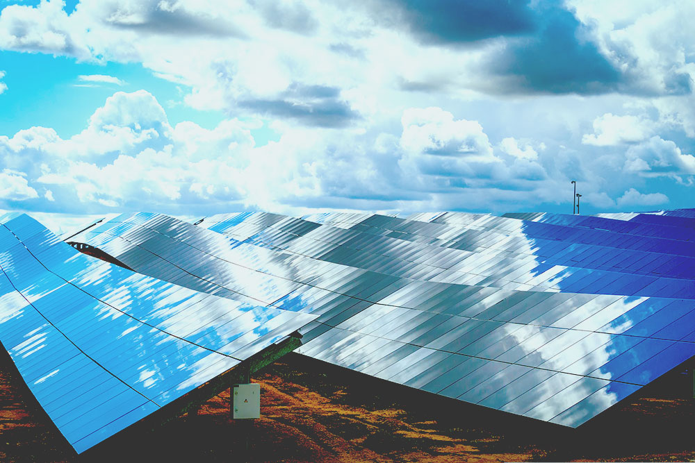 Silicon panels of solar batteries against the cloudy sky in the middle of the day