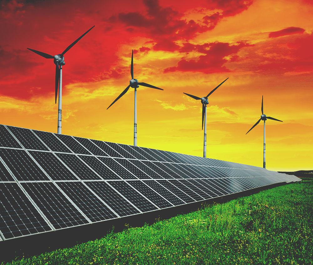 Solar energy panels with wind turbines on orange sky