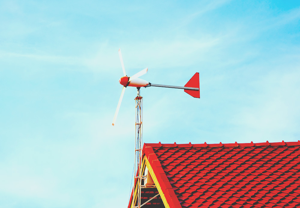 residential wind turbine on roof of house with red shingles web