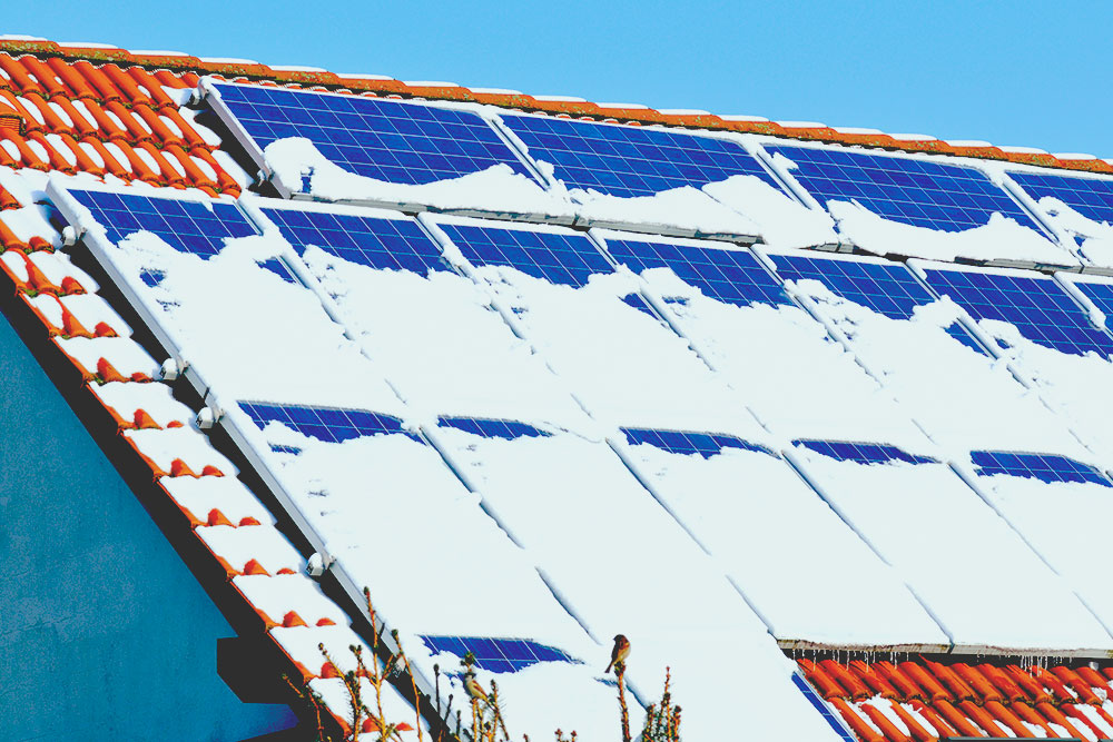 solar panels covered in snow in winter