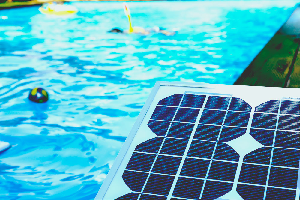 solar panel next to a swimming pool